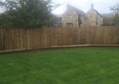 Closed board fence with capping