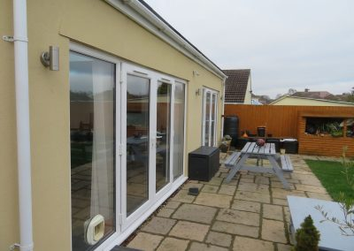 External colour render and patio to extension Chippenham. 1