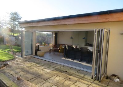 Kitchen and family room extension with Aluminium bi-folding doors,