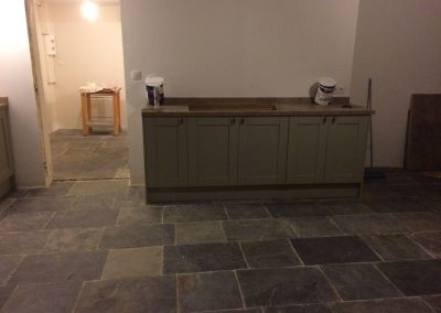 Natural slate flooring and kitchen France.